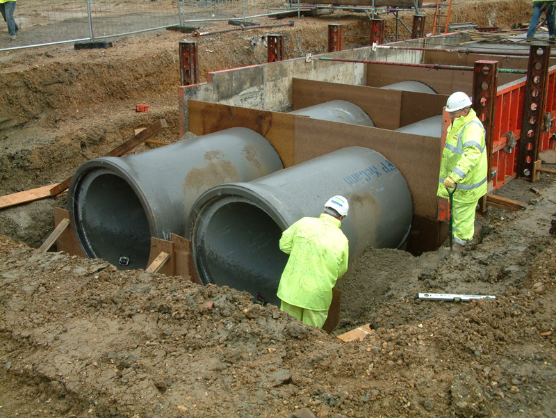 Rigid pipeline system with flexible joints for conveyance of stormwater and storage / attenuation, available with optional dry weather flow channel and side entry manhole access.