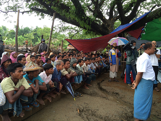UN officials meet with the population of an affected village in Rakhine state (2015).Credit: FAO/ Bui Thi Lan