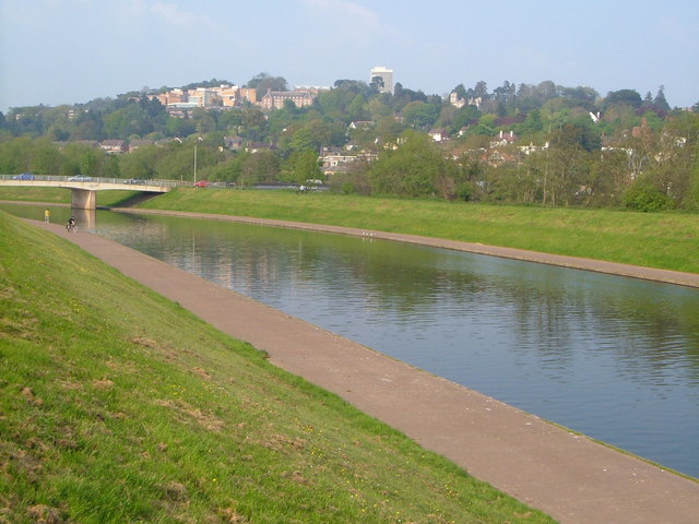 Exe Flood Relief Channel. Looking upstream to the Station Road bridge, with University buildings on the hill behind.