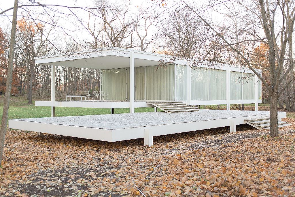The Farnsworth House by Ludwig Mies van der Rohe between 1945 and 1951. The enclosed space and a screened porch are elevated five feet on a raised floor platform, just slightly above the 100 year flood level