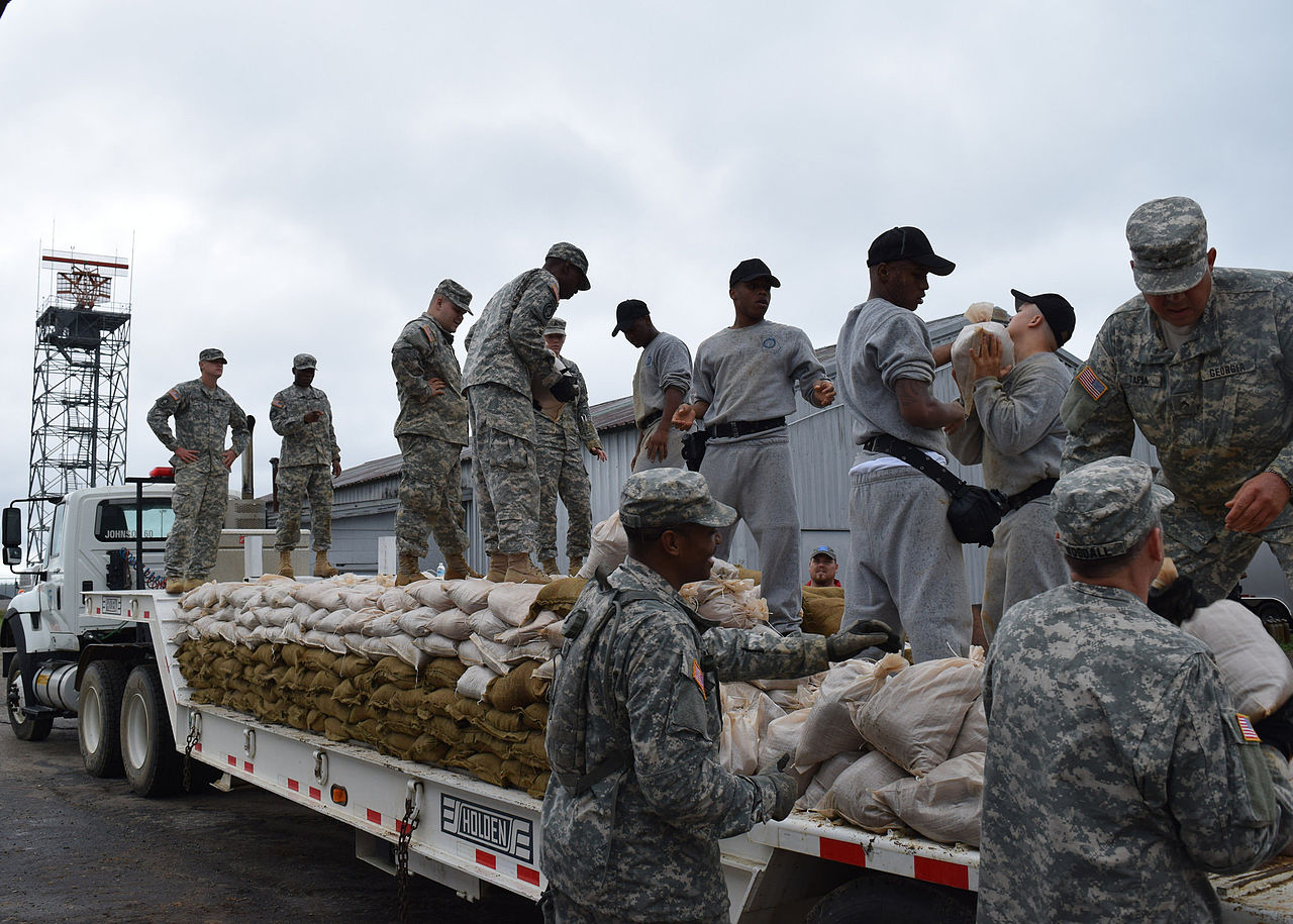 Members of the Georgia National Guard filling sandbags in preparation for floods.